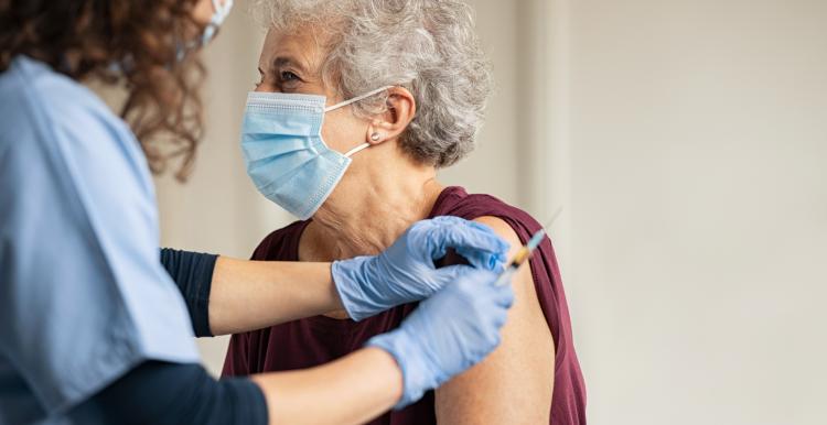 Lady receiving vaccine jab
