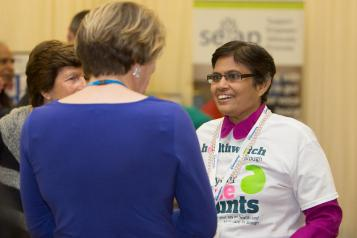 Healthwatch volunteer talking to a member of the public