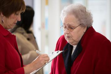 Elderly lady taking survey